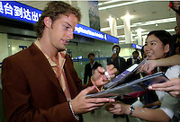 British Formular One driver Jensen Button of the British American Racing F1 Team (B.A.R. F1) signs autographs for racing fans at the Pudong International Airport in Shanghai, China. Button is in Shanghai to promote F1 racing to the Chinese public, China will host its first F1 race in September 2004; at the Shanghai International Circuit..
