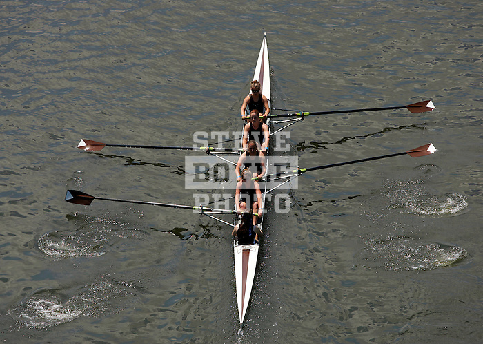 A four woman crew rows down the river as they compete during the 68th Dad Vail Regatta on the Schuylkill River in Philadelphia, Pennsylvania on May 12, 2006........
