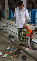Borobudur, Java, Indonesia.  Little Boy and Father Leaving Neighborhood Mosque after Friday Noon Prayers.