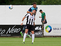 Garry Thompson of Wycombe Wanderers wins the header from Sam Barratt of Maidenhead United during the Friendly match between Maidenhead United and Wycombe Wanderers at York Road, Maidenhead, England on 30 July 2016. Photo by Alan  Stanford PRiME Media Images.