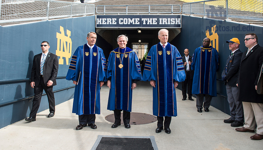 May 15, 2016; University of Notre Dame president Rev. John Jenkins, C.S.C. is flanked by Laetare Medal recipients, John Boehner, former Speaker of the House and Vice President Joe Biden before walking on to the stage for the 2016 Commencement Ceremony. (Photo by Barbara Johnston/University of Notre Dame)