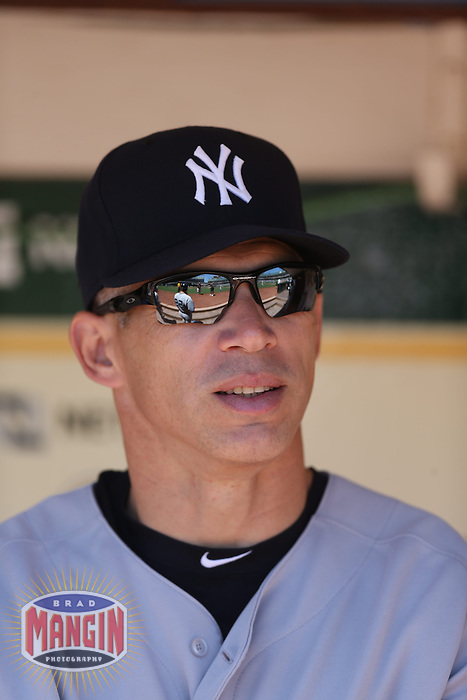 OAKLAND, CA - JUNE 13:  Manager Joe Girardi #28 of the New York Yankees gets ready in the dugout before the game against the Oakland Athletics at O.co Coliseum on Thursday June 13, 2013 in Oakland, California. Photo by Brad Mangin