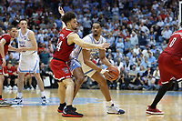 CHAPEL HILL, NC - FEBRUARY 25: Garrison Brooks #15 of the University of North Carolina is defended by Devon Daniels #24 of North Carolina State University during a game between NC State and North Carolina at Dean E. Smith Center on February 25, 2020 in Chapel Hill, North Carolina.