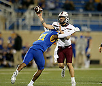 BROOKINGS, SD - MAY 2: Stone Labanowitz #6 of the Southern Illinois Salukis passes the ball while being hit by Don Gardner #21 of the South Dakota State Jackrabbits at Dana J Dykhouse Stadium on May 2, 2021 in Brookings, South Dakota. (Photo by Dave Eggen/Inertia)
