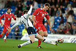 International Friendly match between Wales and Scotland at the new Cardiff City Stadium : Wales' Sam Voke is denied by Stephen McManus of Scotland.