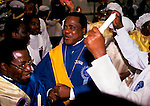 """Black British African church 1990s Uk. Celestial Church of Christ. <br /> Yoruba people harvest festival priests spiritual dancing celebration of faith This west African church was founded by S B J Oshoffa Mainly attended by Yoruba people from western Nigeria the church  flourishes with offshoots in London Paris and New York This  photograph is taken from the book The Storm is Passing Over"""""""