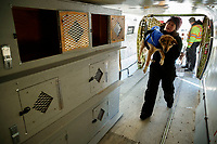 Lead dog drop handler, Shannon Post and Ryan Air employees load 72 dropped dogs into a CASA airplane at the Galena airport during the 2017 Iditarod on Friday afternoon March 10, 2017.<br /> <br /> Photo by Jeff Schultz/SchultzPhoto.com  (C) 2017  ALL RIGHTS RESERVED
