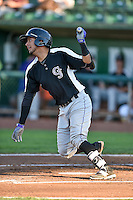 Joel Diaz (5) of the Grand Junction Rockies follows through on his swing against the Ogden Raptors during the Pioneer League game at Lindquist Field on August 25, 2016 in Ogden, Utah. The Rockies defeated the Raptors 12-3. (Stephen Smith/Four Seam Images)