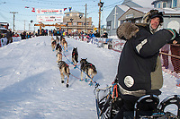 Ray Redington Jr. runs up the chute to the finish line in Nome on Wednesday March 14th during the 2018 Iditarod Sled Dog Race.  <br /> <br /> Photo by Jeff Schultz/SchultzPhoto.com  (C) 2018  ALL RIGHTS RESERVED