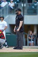 Home plate umpire Travis Godec works the <br /> International League game between the Toledo Mud Hens and the Charlotte Knights at BB&T BallPark on April 23, 2019 in Charlotte, North Carolina. The Knights defeated the Mud Hens 11-9 in 10 innings. (Brian Westerholt/Four Seam Images)