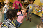 Education Preschool 2-3 year olds music movement dance group having a happy time
