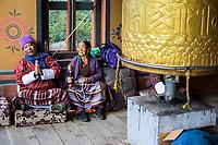 Thimphu, Bhutan.  Worshipers and Prayer Wheels at the National Memorial Chorten.
