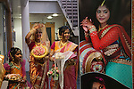 Hindu Coming of Age celebration party London Uk The display photograph is of the young woman. She is on the left with hand raised, with her mother. She is 16yrs old. Mitcham south London Uk They  are welcoming guests to the very big Ritusuddhi, also called as Ritu Kala Samskara party.2016, 2010s,