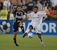DC United midfielder Ben Olsen (14) battles for the ball with Houston Dynamo Dwayne De Rosario (14). DC United defeated Houston Dynamo 2-1, at RFK Stadium in Washington DC, Saturday, May 26, 2007.