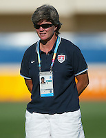 23 August 2004:   USA Women's Head Coach April Heinrichs watches her team warms up during practice before the game during the semifinal game at Pankritio Stadium in Heraklio, Greece.     USA defeated Germany, 2-1 in overtime.   Credit: Michael Pimentel / ISI