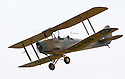 """13/03/15<br /> <br /> First flight.<br /> <br /> ***FULL STORY HERE:   http://www.fstoppress.com/articles/tiger-moth-restorations/    ****<br /> <br /> You may remember spending hours toiling over Airfix models, painstakingly following intricate instructions and trying not to glue your fingers together before painting your own miniature version of one of the RAF's or Luftwaffe's finest aircraft. Then spare a thought for one man who has just helped to restore and put together one World War Two Tiger Moth and is about to start piecing together another FOUR aircraft that were discovered in bits in a barn.<br /> <br /> Sixty-year-old Colin Temple-Smith – who wears a moustache that any Wing Commander would be proud of – has spent a lifetime restoring vintage cars and motorcycles and recently quit his job as a window fitter to help re-build the five bi-planes that will become part of a growing fleet of Tiger Moths at Derbyshire based Blue Eye Aviation.<br /> <br /> Today saw the first of the fully-restored five aircraft take to the skies.<br /> <br /> """"It's just like working on old bikes and cars, although they're a lot more fragile"""" explained Colin, whose wife runs the Aviators Café at Darley Moor Airfield near Ashbourne.<br /> <br /> """"When I was a teenager I used to be a member of a modelling club, making flying models from wood and canvas. They're very similar to build – it's really just the size that's changed with these.<br /> <br /> All Rights Reserved: F Stop Press Ltd. +44(0)1335 418629   www.fstoppress.com."""