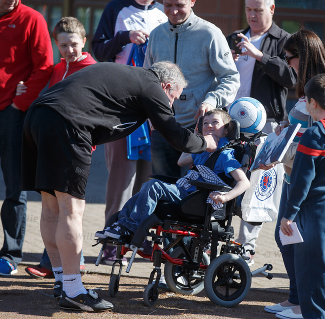 Ally McCoist takes time out to greet the disabled kids who have gathered to watch the team at training