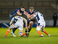 19th December 2020; AJ Bell Stadium, Salford, Lancashire, England; European Champions Cup Rugby, Sale Sharks versus Edinburgh;   Ross Harrison of Sale Sharks  is tackled by  Ben Toolis and  Nic Groom of Edinburgh Rugby