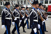 Switzerland. Geneva. A group of recruits ( policemen and policewomen) from the police academy march past during their last training session. They wear uniforms, white gloves, tricorns on the heads and carry old rifles with bayonet on the shoulders. In a few hours, they will be all sworn in as police officers. The tricorne or tricorn is a style of hat that was popular during the 18th century, falling out of style by 1800. The tricorne was worn as part of military uniforms. A bayonet (from French ba?onnette) is a knife, sword, or spike-shaped weapon designed to fit in, on, over or underneath the muzzle of a rifle, effectively turning the gun into a spear. 29.08.12 © 2012 Didier Ruef...