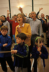 "Family group children parents parent singing worshipping church service congregation in Saham Toney ""village hall"" Norfolk  UK England 1990s UK"