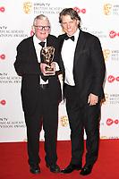 John Motson and John Bishop<br /> in the winners room for the BAFTA TV Awards 2018 at the Royal Festival Hall, London<br /> <br /> ©Ash Knotek  D3401  13/05/2018