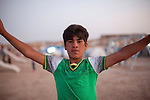 DOMIZ, IRAQ: A young Syrian refugee in the Domiz refugee camp..Over 7,000 Syrian Kurds have fled the violence in Syria and are living in the Domiz refugee camp in the semi-autonomous region of Iraqi Kurdistan...Photo by Ali Arkady/Metrography