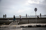 Mumbai, India<br /> Ocean drive - one of the most expensive streets in the world to live. Many locals relax on the sea wall or walk the pavement to enjoy the view.<br /> <br /> <br /> <br /> <br /> Picture by Gavin Rodgers/ Pixel8000<br />  07917221968
