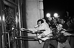 Demonstrators smash glass out of the front doors of the San Francisco City Hall, May 22, 1979. About 5,000 persons marched from the city's gay community to City Hall, protesting the voluntary manslaughter conviction of Dan White in the fatal shootings of the mayor and a supervisor. (AP Photo/Paul Sakuma)