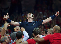 Gent, Belgium, November 29, 2015, Davis Cup Final, Belgium-Great Britain, day three, Andy Murray (GBR) screams it out in celebration while he is is liften up by his team members, Great Britain wins the Davis Cup 2015.<br />
