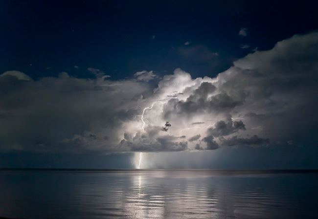 an isolated lightning storm over Lake Superior