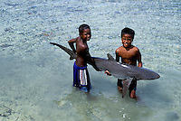 Local Boys from Palau Micronesia with a beached Shark