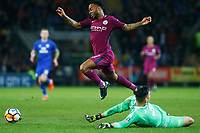 Raheem Sterling of Manchester City leaps over Neil Etheridge of Cardiff City during the Fly Emirates FA Cup Fourth Round match between Cardiff City and Manchester City at the Cardiff City Stadium, Wales, UK. Sunday 28 January 2018