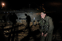 An Israeli soldier and a tank outside its base, near the southern Israel-Gaza border. Israeli forces began an air offensive against Hamas in Gaza on 27/12/2008, which quickly escalated into an offensive by land, sea and air, in retaliation against Palestinian rockets fired into Israel. After eight days of bombardment, leaving over 400 Palestinians and four Israelis dead, Israeli tanks entered Gaza on 04/01/2009...