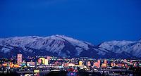 Skyline of Salt Lake City, Utah with snowcovered Wasatch Mountains in the background. cityscape, urban design, night shot. Salt Lake City Utah.