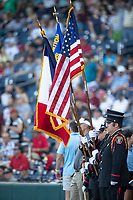 Omaha Fire Department Honor Guard before Game 10 of the NCAA College World Series on June 20, 2019 at TD Ameritrade Park in Omaha, Nebraska. Louisville defeated Mississippi State 4-3. (Andrew Woolley/Four Seam Images)