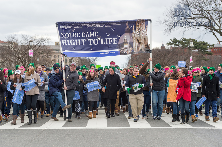 January 27, 2017; University of Notre Dame President Rev. John Jenkins, C.S.C., (center) marches with students, faculty, and staff from Notre Dame, Saint Mary's, and Holy Cross College at the National March for Life in Washington, D.C.  (Photo by Barbara Johnston/University of Notre Dame)