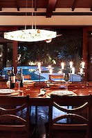 Outdoor dining table and chairs by swimming pool at night