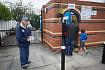 Ramsbottom United 1 Barwell 3, 03/10/2015. Riverside Stadium, Northern Premier League. Jack Wolfenden, aged 83, selling programmes outside the Harry Williams Riverside Stadium, home to Ramsbottom United before they played Barwell in a Northern Premier League premier division match. This was the club's 13th league game of the season and they were still to record their first victory following a 3-1 defeat, watched by a crowd of 176. Rams bottom United were formed by Harry Williams, the current chairman, in 1966 and progressed from local amateur football  in Bury to the semi-professional leagues. Photo by Colin McPherson.