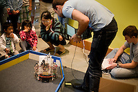People look at robotics demonstrations in the Stata Center during the MIT Under the Dome open house in Cambridge, Massachusetts, USA.