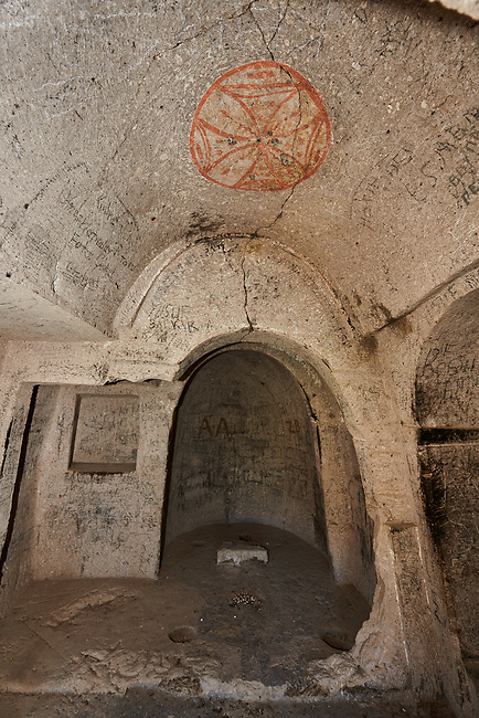 "Pictures & images of Komurlu Church interior,  9th century, the Vadisi Monastery Valley, ""Manastır Vadisi"",  of the Ihlara Valley, Guzelyurt , Aksaray Province, Turkey.<br /> <br /> Kalburlu (St. Epthemios) church dates back to the 9th or 10th century. It is carved out of a single rock massive with rock columns holding up the roof of its church . The arches of Kalburlu (St. Epthemios) church have rich architectural decorated relif sculptures. The naves are connected by rounded arches & there is a baptismal font to the east of the main entrance."