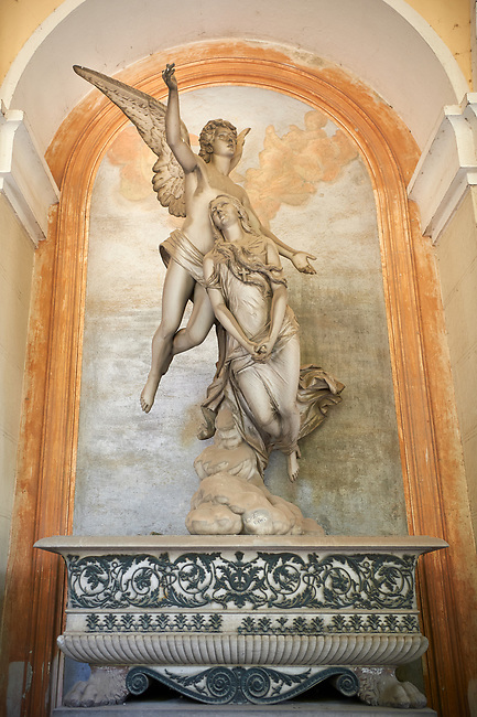 Picture and image of the stone sculpture commissioned by Luigi Parpaglioni, a rich trader coming from the Lombardy, because of his daughter's death. The funery monument depicts  flying angel going before the soul who is rising up to the sky.  This romantic style is typical of the pre raphilites and although realistic the style is a little stilted. The Papaglioni tomb became popular and was copied by sculptors in many other countries.  Tomb Parpaglioni sculptor F. Fabiani 1884. Section A, no 35, The monumental tombs of the Staglieno Monumental Cemetery, Genoa, Italy