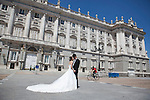A couple of recently engaged japaneses are taken photos dressed on their wedding clothes in front of the `Palacio Real de Madrid´ Madrid´s Royal Palace in Madrid, Spain. Today, King Juan Carlos of Spain made a public announcement of his abdication will, his son, Prince Felipe of Spain, will become Spain´s king after the official ceremony. June 02, 2013. (ALTERPHOTOS/Victor Blanco)