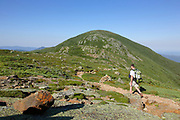 Hiker traveling south along the Crawford Path (Appalachian Trail) in Sargent's Purchase in the New Hampshire White Mountains during the summer months; this area is part of the Southern Presidential Range. Named after President Dwight D. Eisenhower, Mount Eisenhower is straight ahead. This mountain was once called Mount Pleasant, but was renamed Mount Eisenhower after President Eisenhower died.
