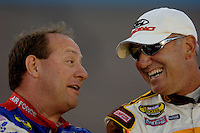 Apr 20, 2006; Phoenix, AZ, USA; Nascar Nextel Cup racer Ken Schrader driver of the (21) Motorcraft Ford Fusion chats with Dale Jarrett driver of the (88) UPS Ford Fusion during qualifying for the Nextel Cup Subway Fresh 500 at Phoenix International Raceway. Mandatory Credit: Mark J. Rebilas