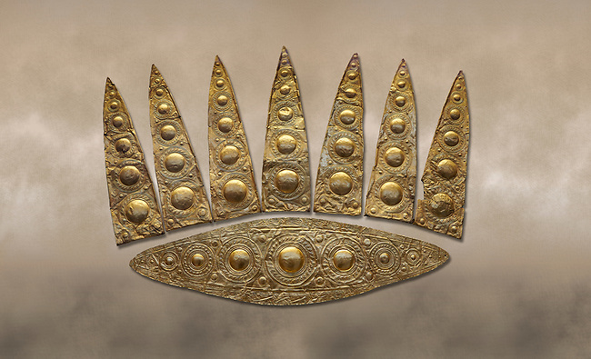 Top leaf shapes of a Mycenaean gold diadem from Grave III, 'Grave of a Women', Grave Circle A, Myenae, Greece. National Archaeological Museum Athens.<br /> <br /> Cat No 3,5. 16th century BC.<br /> <br /> Shaft Grave III, the so-called 'Grave of the Women,' contained three female and two infant interments. The women were literally covered in gold jewelry and wore massive gold diadems, while the infants were overlaid with gold foil.