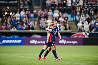 TACOMA, WA - JULY 31: Eugenie Le Sommer #9 and Dani Weatherholt #17 of the OL Reign celebrate together during a game between Racing Louisville FC and OL Reign at Cheney Stadium on July 31, 2021 in Tacoma, Washington.