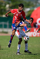Alfredo Stephens (19) of Panama tries to stop Luis Sequeira (8) of Costa Rica from gaining possession during the quarterfinals of the CONCACAF Men's Under 17 Championship at Catherine Hall Stadium in Montego Bay, Jamaica. Panama defeated Costa Rica, 1-0.