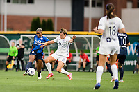 TACOMA, WA - JULY 31: Tziarra King #23 of the OL Reign and Savannah McCaskill #7 of Racing Louisville FC battle for the ball during a game between Racing Louisville FC and OL Reign at Cheney Stadium on July 31, 2021 in Tacoma, Washington.