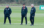 Cardiff - UK - 19th March 2013 : Wales Football Manager Chris Coleman with his coaching staff Osian Roberts (left) and Kit Symons (right) during a training session at the Vale Hotel near Cardiff ahead of their game with Scotland at the weekend.