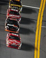 Feb 07, 2009; Daytona Beach, FL, USA; NASCAR Sprint Cup Series driver Tony Stewart (14) leads Denny Hamlin (11) and Kasey Kahne (9) during the Bud Shootout at Daytona International Speedway. Mandatory Credit: Mark J. Rebilas-